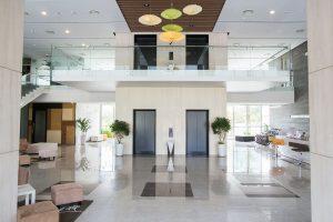 Empty lobby of condominium building. Elevators in hall of modern business center. Stylish interior design concept